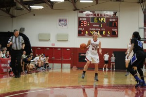 Heather Wheat, junior guard, sets up the offense for the Lady Grenadiers.  Wheat leads the team in scoring for the season at 17 points per game.