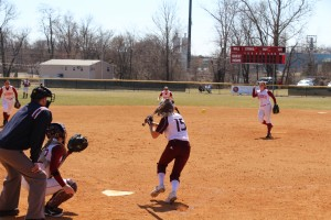 Senior pitcher Jenna Swain slings a fast ball in to an opposing hitter during Saturday's double header.  Swain went 10-3 last year with a team high 99 strikeouts.
