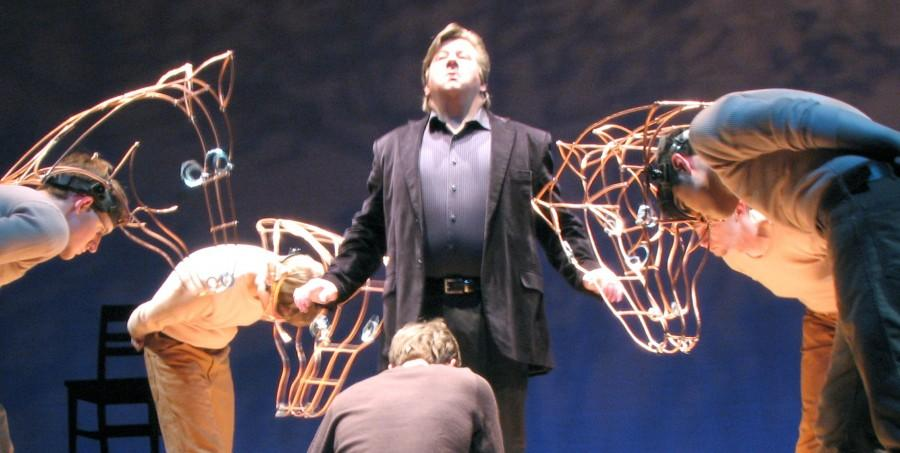 "Drew Cash, University of Louisville graduate, bows down before J.R. Stuart, professional actor, as the actors playing horses — Robbie Hudgell, theatre junior, Chris Snyder, bioinformatics junior, and Phillip Rivera, theatre sophomore — bow down, as well. This play, ""Equus,"" was recently performed in the Robinson Theater of the Ogle Center."