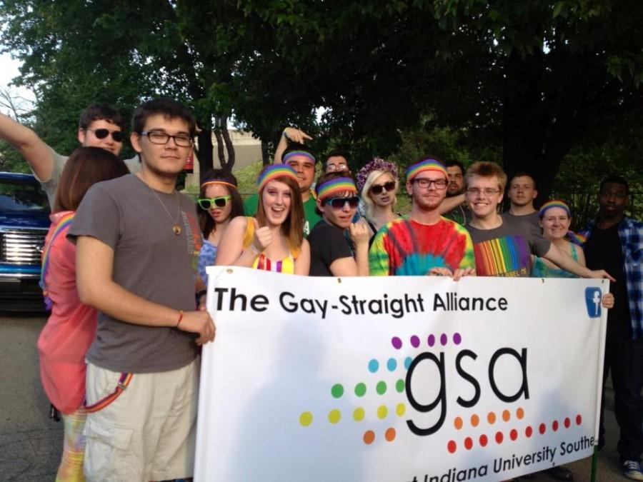 Members of the IU Southeast Gay-Straight Alliance showed their colors in the Kentuckiana Pride Parade June 14. Banner holders from left to right: Justin Armenta, psychology junior, Mallory Murphy, international business and marketing sophomore, Dylan Kidwell, English and French sophomore and GSA President, Calvin Barron, education sophomore, Geoff Hutton, vocal performance alumnus and Amanda Abell, general studies alumna.