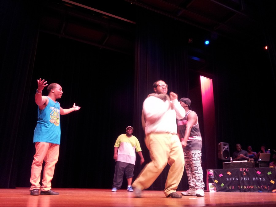 The Bel-Air Gents group from the Phi Beta Sigma fraternity dance to