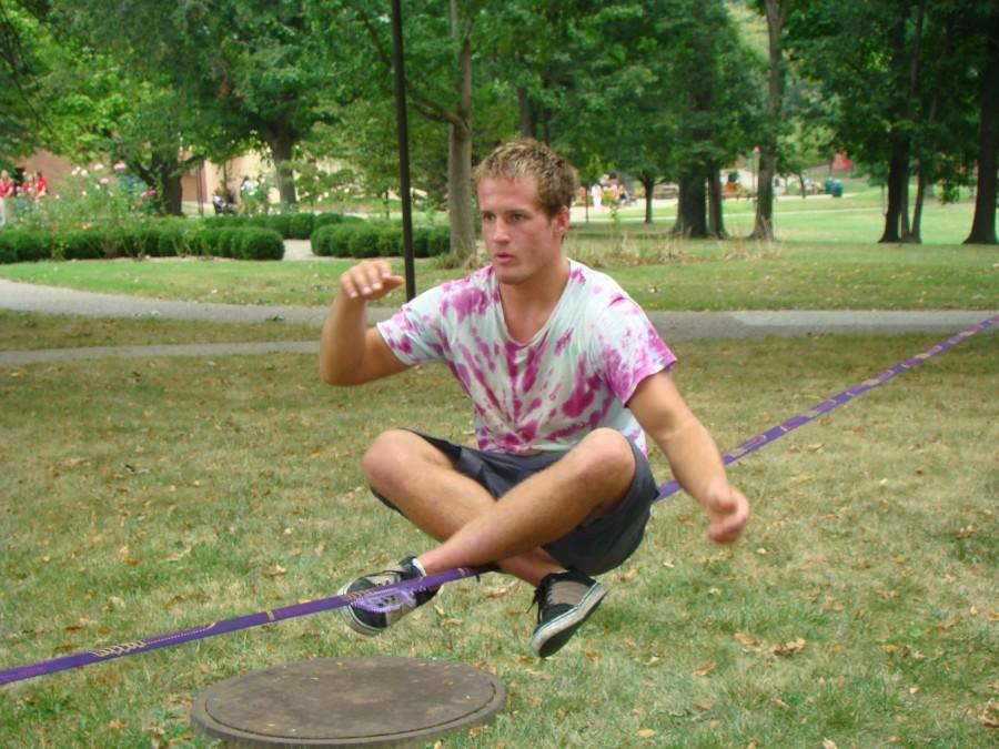 Tyler Newcomb, philosophy freshman, practices slacklining outside Crestview Hall. Newcomb frequently practices in between classes.