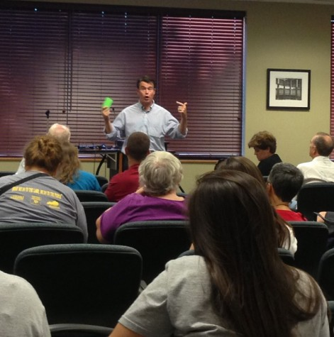 Todd Young speaks to students and community members at a town hall forum.