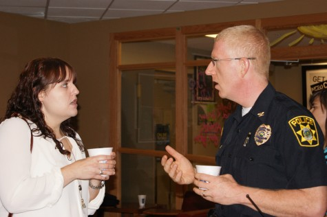 Chief Charles Edelen answers questions and socializes with students at the Coffee with a Cop event held at University Grounds.