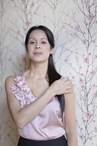 Erika Del Pilar Bouttier was diagnosed with breast cancer at 41. She had no family history of cancer, no abnormal lumps, and never a suspicious mammogram. Now, even years later, Bouttier bears the scars from her battle with cancer. Photo by Angela Anderson Photography