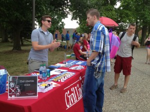 Civil liberties Union president, Dejan Tomanix discusses the group with an interested student at the CLU booth during the Week of Welcome