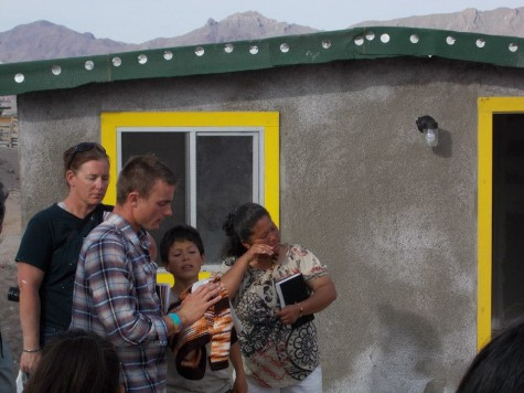 A woman cries at the dedication ceremony of her new home in Juarez, Mexico.
