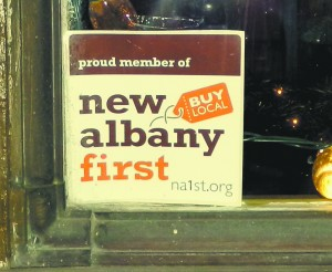 This sticker, tucked inside the window of Colokial, shows that the boutique is a member of New Albany First, a non-profit organization that supports local businesses.