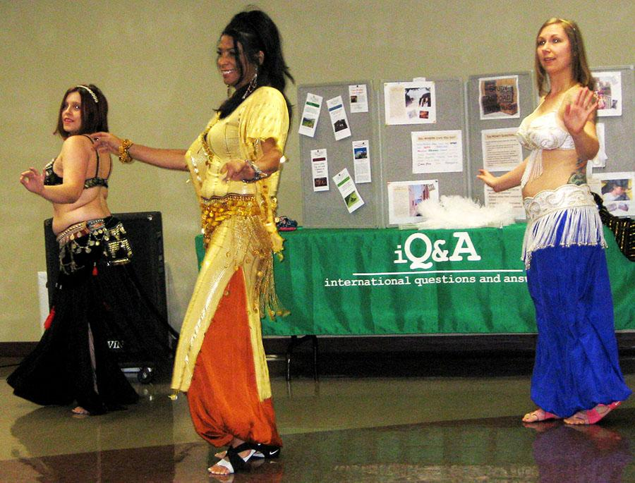 Amy, Raqia and Lillie begin with a dance to tribal music. The dancers are from Raqia's studio, Belly Dancing and More located, in downtown New Albany.