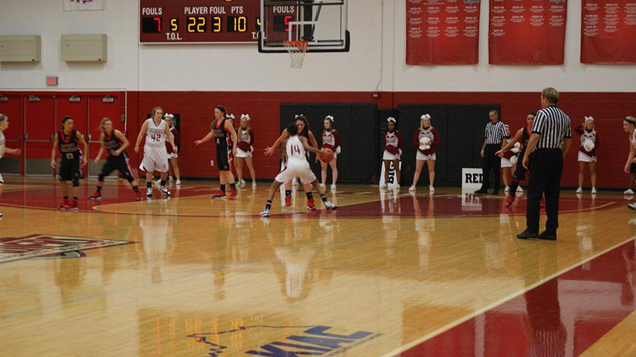 Freshman forward, Jade Spaulding crosses over a defender before scoring two of her 14 points in the Grenadiers blow out win over the Knights.