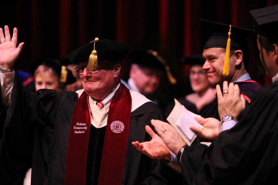 Chancellor Wallace receives applause after being officially recognized as chancellor.