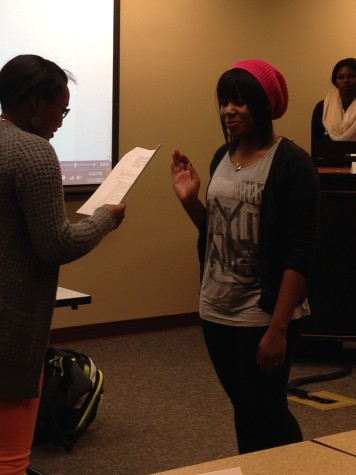 Angel Russell, sociology junior and SGA chief justice, swears in Rebeccah Nesbitt, international studies sophomore, during the SGA meeting on Thursday, Jan. 15. Nesbitt is the newest senator in the SGA