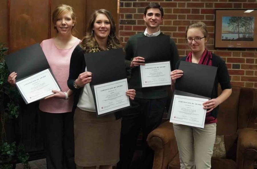 The four contestants of the speech competition with their awards.