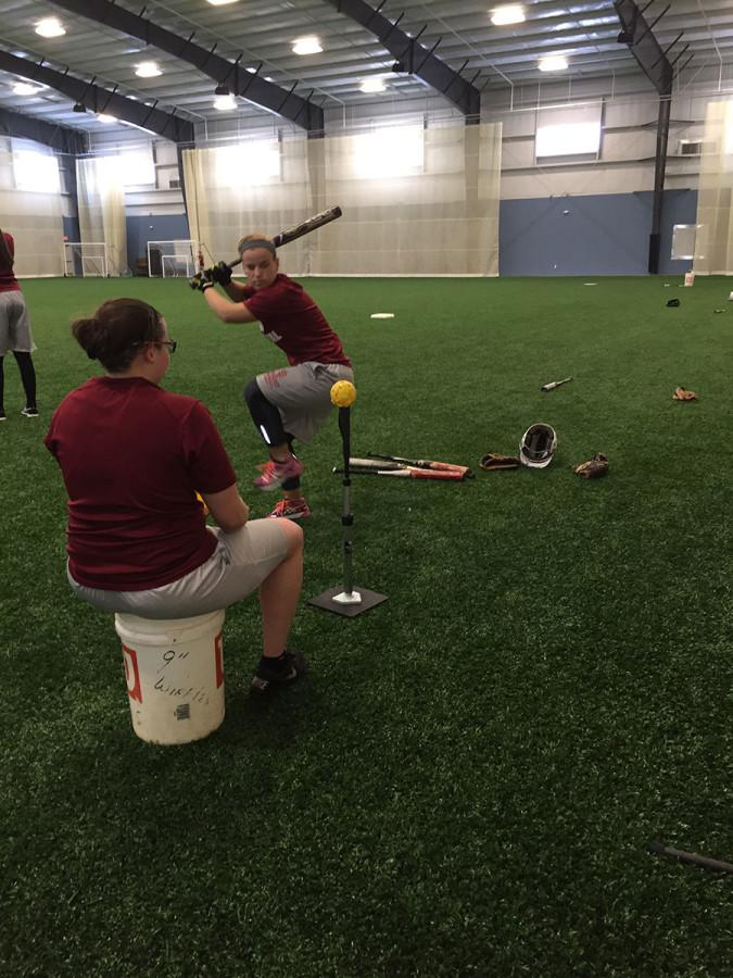 Senior captain Summer Sanders working on her hitting.