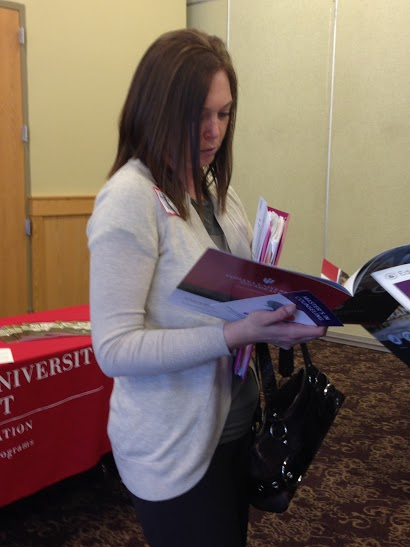 Ashley+Wells%2C+special+education+senior%2C+reads+materials+that+were+provided+during+the+Education+Job+Fair.+The+job+fair+occurred+on+Tuesday%2C+March+17+from+4+to+6+p.m.+in+the+Hoosier+Room