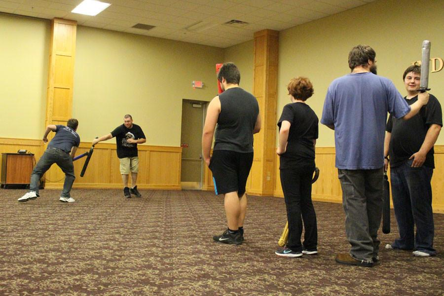 Society members wait their turn in line for a chance at glory. In this game type, two members face off against each other and the victor survives to challenge the next opponent. The loser marches to the back of the line to wait for another shot.