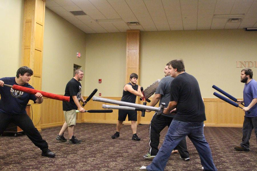 The students decided that one versus one combat was too boring and raised the stakes. The members get into teams of three and face off.