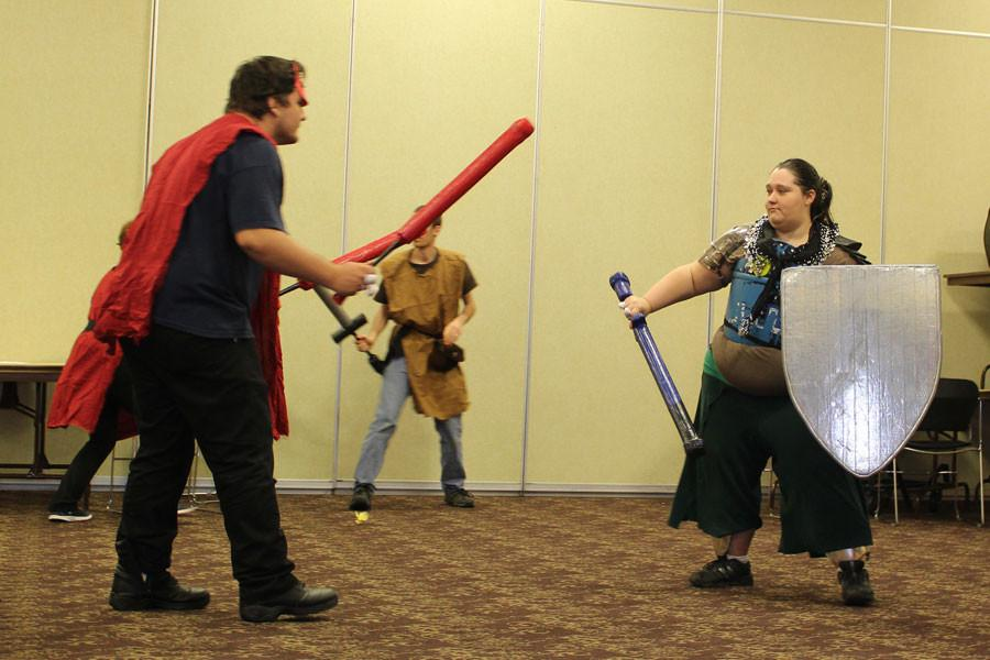 Jessica Brown wields sword and shield against the onslaught of fire monsters. This battle took place early in the event and was an easy win for the adventurers. They gained much needed experience for the long journey ahead.