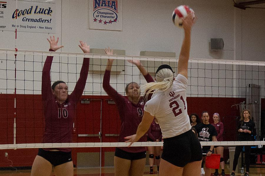 Hannah Joly, freshman outside hitter, goes up for a spike against IU East. The Grenadiers swept the match in straight sets.