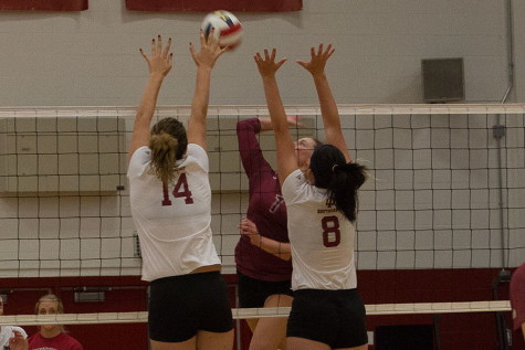 Sophomores Michala Beasley and Kelsey Willinger go up for a block against IU East on Thursday, Sept. 10. The Grenadier's defense was great getting four blocks against the Red Wolves.