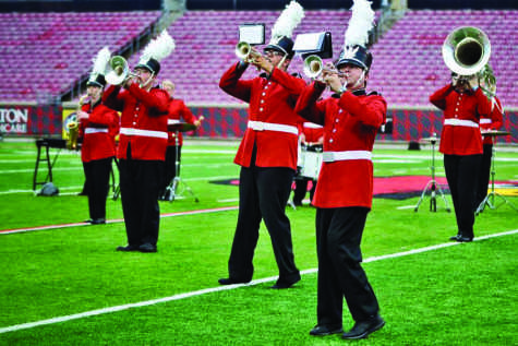 "Members of Southeast Sound perform ""Fuego"" in exhibition at the Papa John's Cardinal Stadium in Louisville on Friday, June 19."