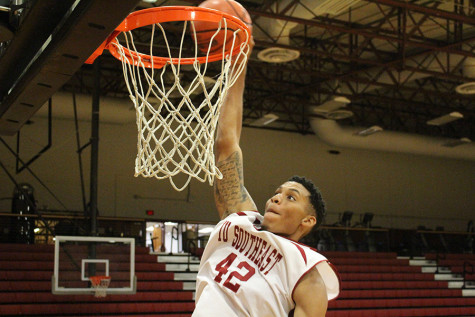Jordan Thompson, senior forward, dunking the ball in the Activities Building. Thompson is also pitching for the IUS men's baseball team during his senior year.