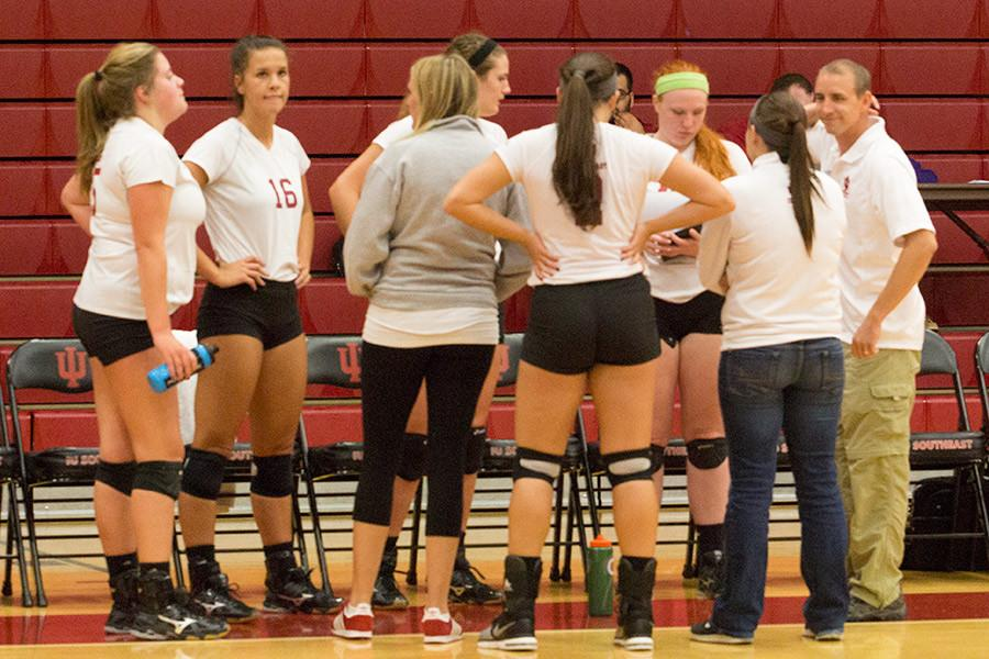 The IUS volleyball team huddles up after a set in their match against Midway University on Tuesday, Oct. 13. The Grenadiers won the match and continued their win streak to seven games.
