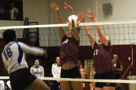 Katie Fischer, junior middle blocker, and Monica Loftus, freshman right side hitter, go up for a block in the third set against Asbury on Thursday, Oct. 15. The Grenadiers had eight blocks in the match.