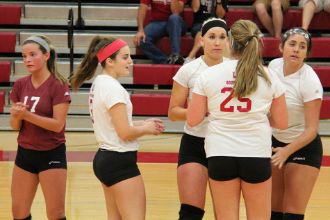 The Grenadiers huddle up after a point in their match against Carlow University on Friday, Oct. 9. With the win, the Grenadiers win their sixth straight game.
