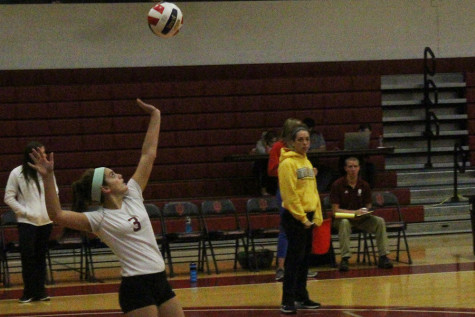Maddie Jacobi, freshman defensive specialist, prepares to serve the ball against Oakland City on Tuesday, Oct. 20. The Grenadiers lost the match in five sets for their second consecutive loss.