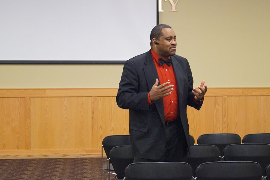 """Joseph Grant, lecturer of criminology and criminal justice, leads the discussion of """"Get on the Bus"""" after the film ended."""