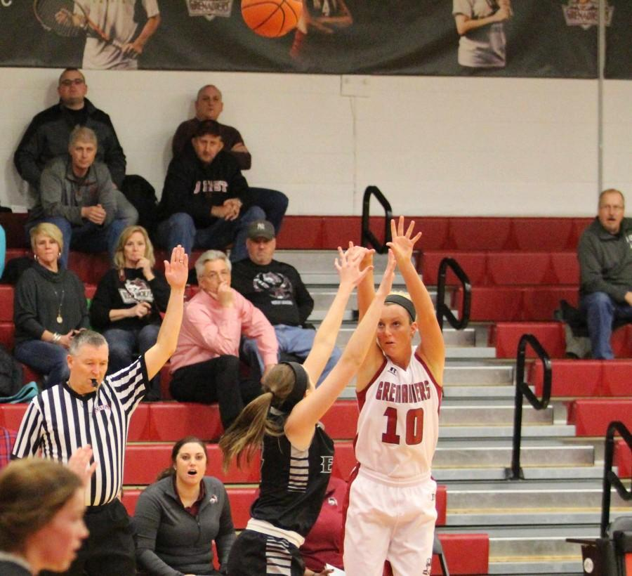 Redshirt+freshman+Josie+Hockman+shoots+a+3-point+basket.+The+Grenadiers+shot+33+percent+from+behind+the+arc.+