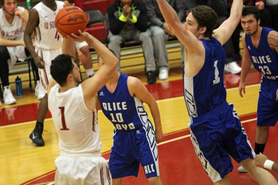 Sophomore guard Jacob Mills shoots a mid-range jump shot over the Eagles' defense.
