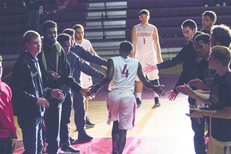 Freshman guard Demetrius Stanton walks down the line of his teammates during the starting lineups.