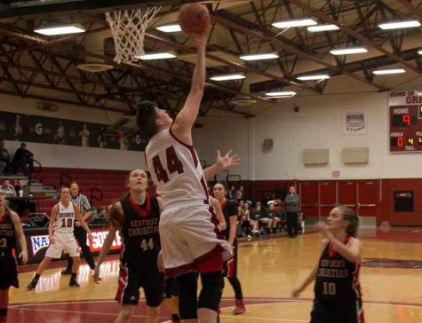 Junior forward Jocelyn Mousty lays up the ball early in the game. She finished with 18 points and 12 rebounds.