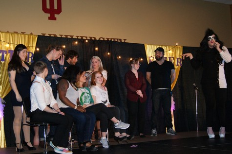"Audience members participate in ""60-second Drag Queen,"" a competition to see who could so the best drag makeup on their partner in 60 seconds. Kelly Howard, psychology junior and production team member, stage-manager Nicholas Moore, and emcee Lucy Panic led the game."