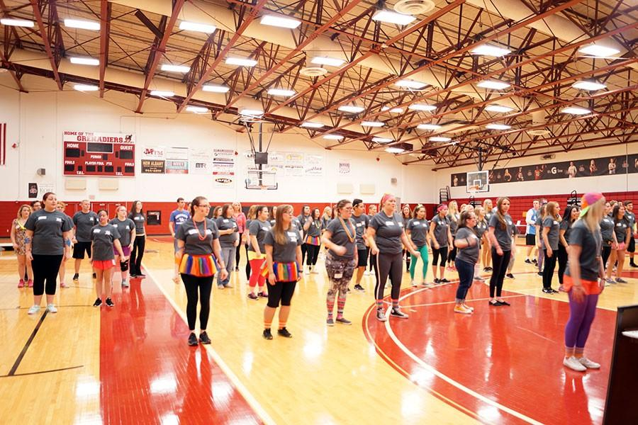 Dance marathon participants learn a dance.
