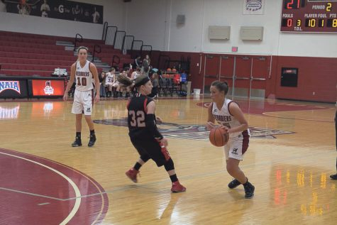 enior guard and transfer from UC - Clermont, Katie Slavey attacks the basket. Slavey played her last three years as a Grenadier. Photo by Parker Henes