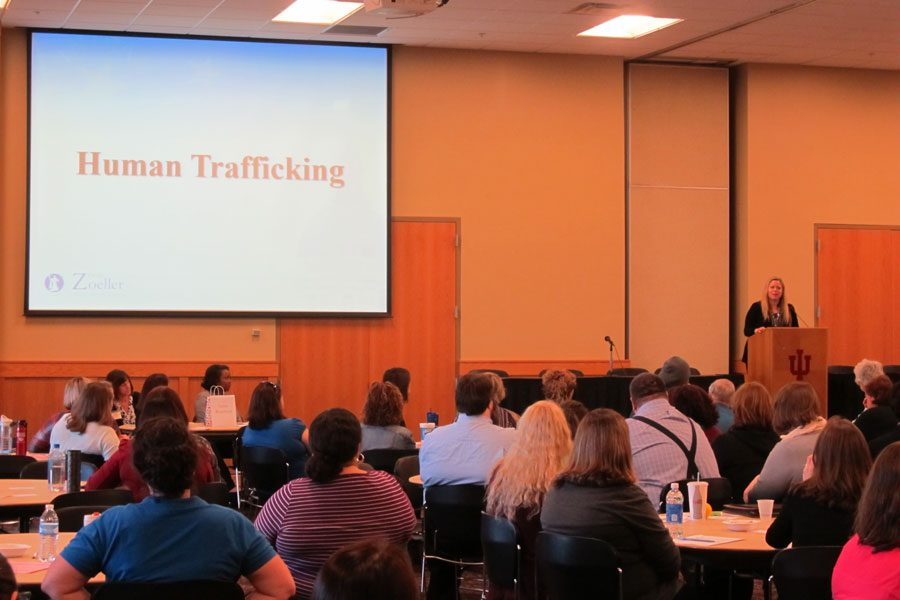 The audience listens to speakers talk about human trafficking and how it is affecting the community.