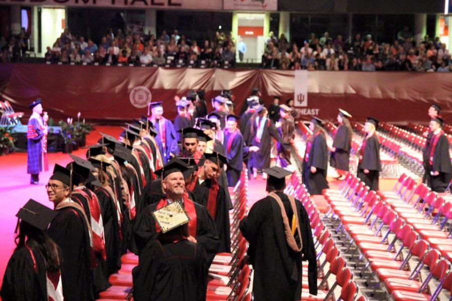 Graduating seniors prepare to take their seats in the Freedom Hall arena for the IUS Commencement ceremony on Monday, May 9.