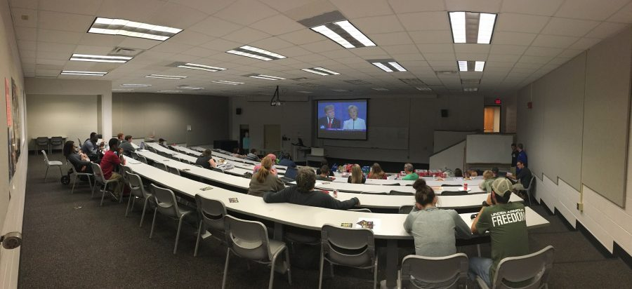 Students watch as the two candidates debate.