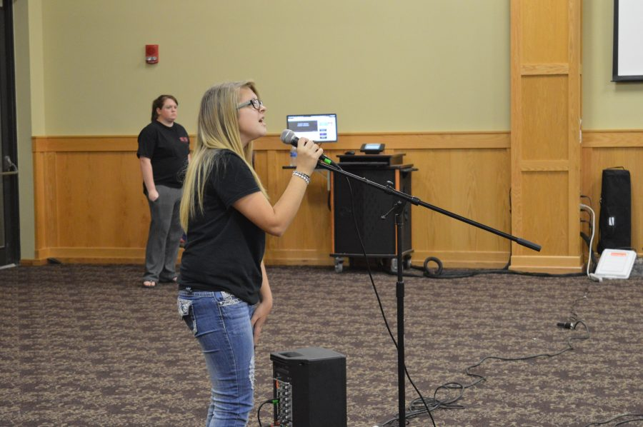 "Lauren Allen, music freshman, singing Carrie Underwood's ""Blown Away"" for the opening performance of Campus Boogie."