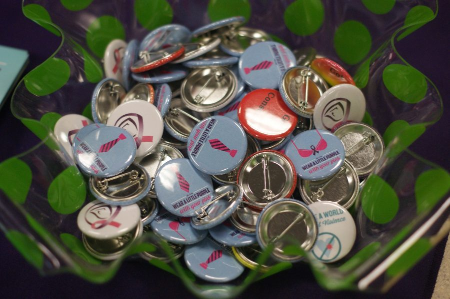 The Center for Women and Families pass out buttons to advocate against sexual and domestic violence.