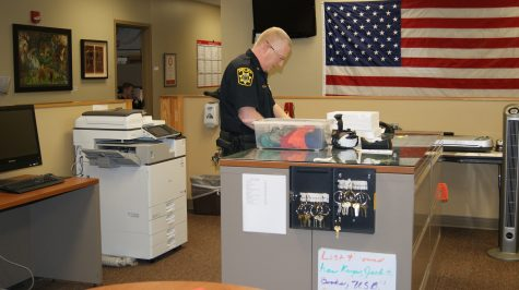IUS Police Chief Charles Edelen filing reports, just one of his many duties in the IUS Police Station.