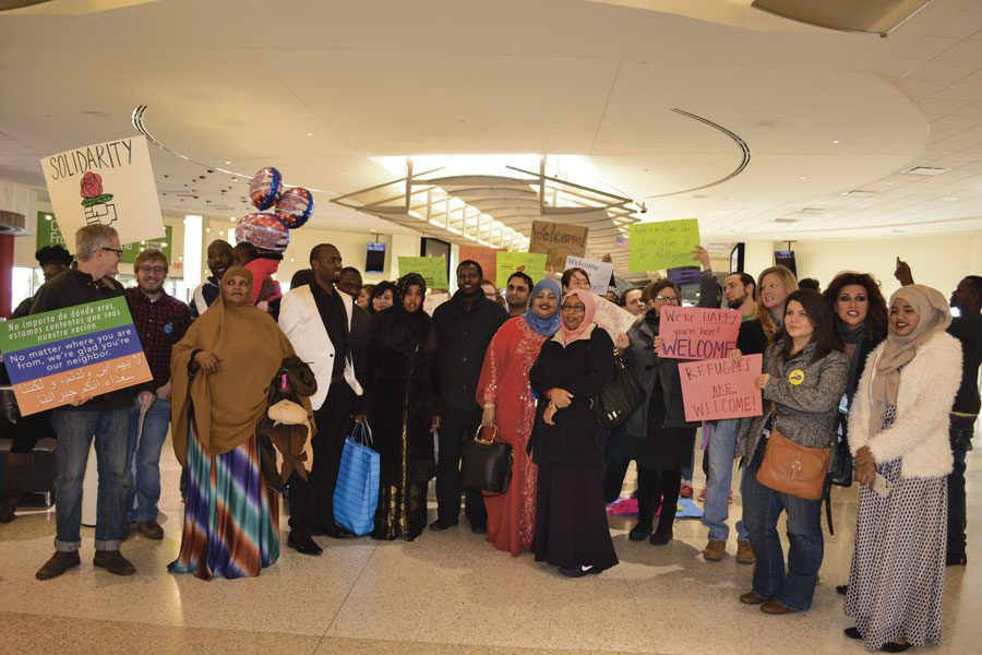 Members of the Kentuckiana community gather at the Louisville International Airport on Friday, Feb. 3, to welcome the last refugees into the city before a temporary shutdown of refugee admissions begins.