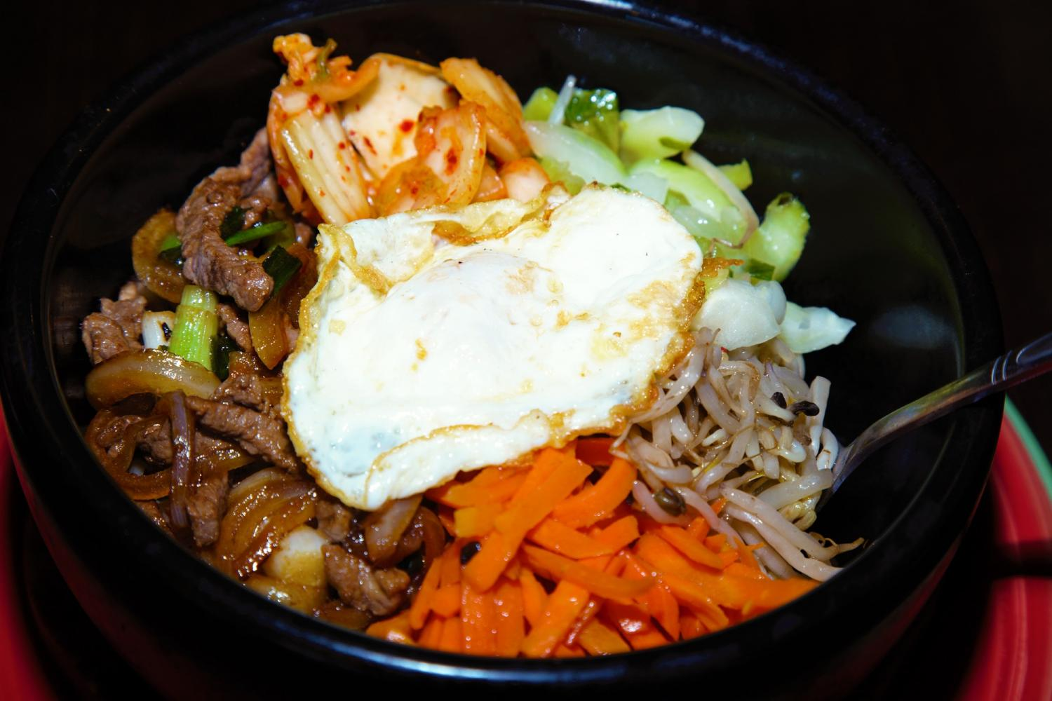 The hot stone bibimbap, a traditional Korean rice dish served in a hot stone, which makes the rice at the bottom crispy.