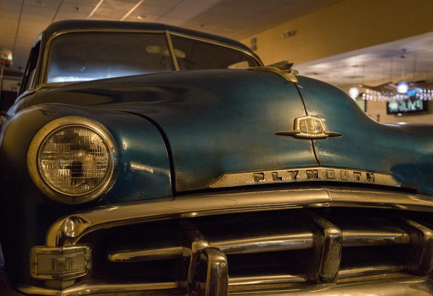 Parked in the restaurant is a 1951 Plymouth