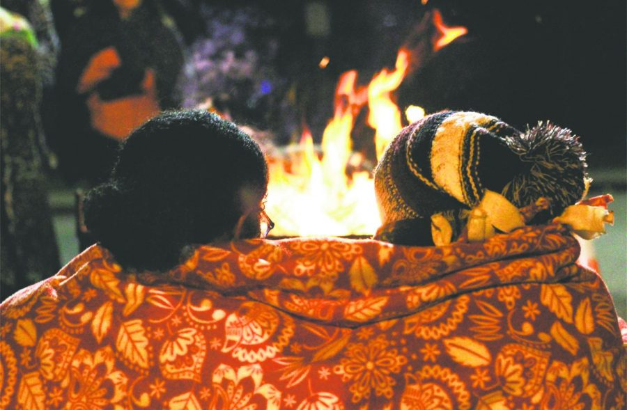 Sophomores Tessa Duncan and Katie Shircliff snuggle up by the fire to keep warm on the chilly November night.