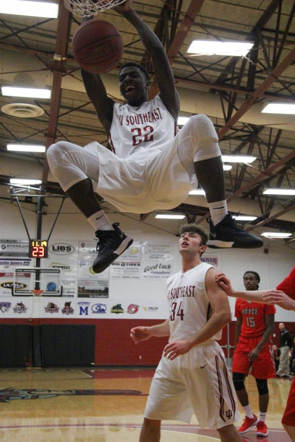 Throughout the game, the Grenadiers pushed past the Bulldogs' defense, enabling Deshawn Lewis, business management sophomore, to achieve a dunk.