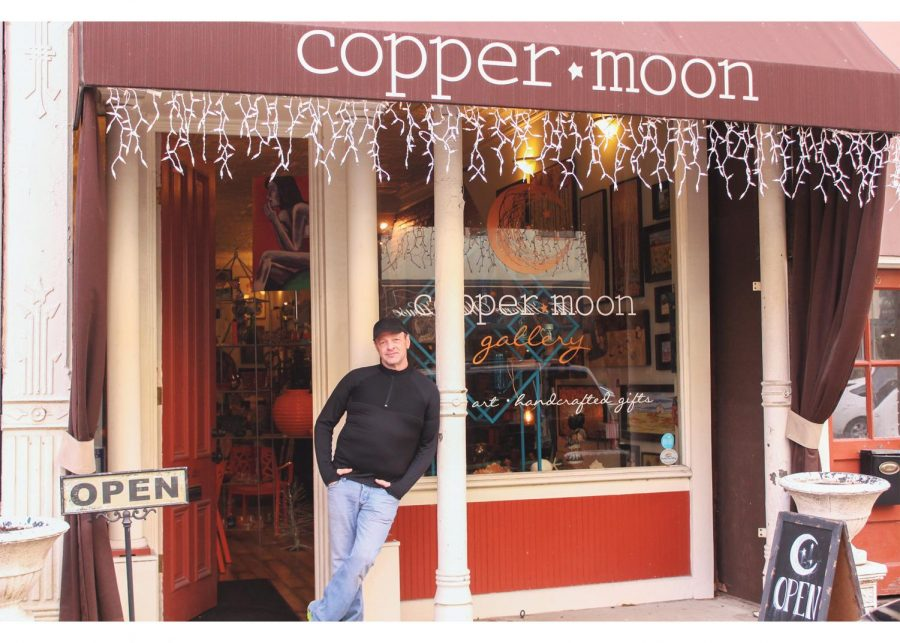 Eli Ivey, new owner of Copper Moon Gallery in downtown New Albany, stands in front of his new gallery. Ivey loves the the gallery's location due to it's close proximity to downtown Louisville.